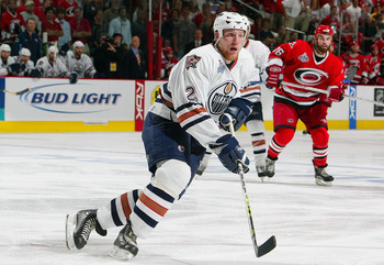 RALEIGH, NC - JUNE 19:  Matt Greene #2 of the Edmonton Oilers skates against the Carolina Hurricanes during game seven of the 2006 NHL Stanley Cup Finals on June 19, 2006 at the RBC Center in Raleigh, North Carolina. The Hurricanes defeated the Oilers 3-1