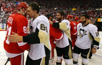 DETROIT - JUNE 12:  Miroslav Satan #81 of the Pittsburgh Penguins shakes hands with Marian Hossa #81 of the Detroit Red Wings after Game Seven of the 2009 NHL Stanley Cup Finals at Joe Louis Arena on June 12, 2009 in Detroit, Michigan.  (Photo by Jim McIs