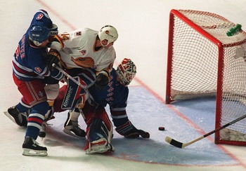 11 JUN 1994: CANUCKS FORWARD GEOFF COURTNALL SLIPS THE PUCK THROUGH THE PADS OF RANGERS GOALTENDER MIKE RICHTER, DESPITE THE EFFORTS OF DEFENSEMAN DOUG LIDSTER, TO GO UP 2-0 IN THE SECOND PERIOD OF GAME SIX OF THE STANLEY CUP FINALS IN VANCOUVER, BRITISH