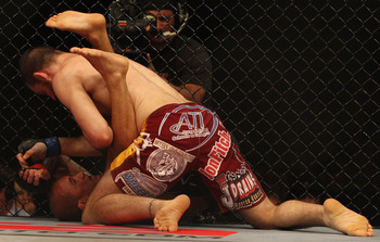 SYDNEY, AUSTRALIA - FEBRUARY 27:  BJ Penn of the USA is pinned down by Jon Fitch of the USA during their welterweight bout part of UFC 127 at Acer Arena on February 27, 2011 in Sydney, Australia.  (Photo by Mark Kolbe/Getty Images)