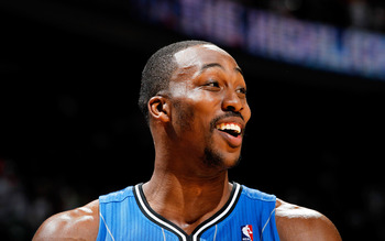 ATLANTA, GA - APRIL 22:  Dwight Howard #12 of the Orlando Magic against the Atlanta Hawks during Game Three of the Eastern Conference Quarterfinals in the 2011 NBA Playoffs at Philips Arena on April 22, 2011 in Atlanta, Georgia.  NOTE TO USER: User expres