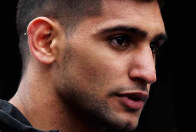 MANCHESTER, ENGLAND - MAY 15:  Boxer, Amir Khan of England looks on prior to being the Official Starter for the BUPA Great Manchester Run on May 15, 2011 in Manchester, England.  (Photo by Dean Mouhtaropoulos/Getty Images)