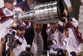 9 Jun 2001: Ray Bourque, coach Bob Hartley, Patrick Roy and Joe Sakic of the Colorado Avalanche celebrate defeating the New Jersey Devils to win the Stanley Cup finals at the Pepsi Center in Denver, Colorado. The Avalanche defeated the Devils 3-1 to win t