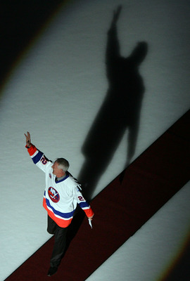 UNIONDALE, NY - MARCH 02:  Former New York Islanders legend Mike Bossy waves to the crowd before the game against the Florida Panthers at the Nassau Coliseum March 2, 2008 in Uniondale, New York. The Islanders are celebrating the 17 men that were part of