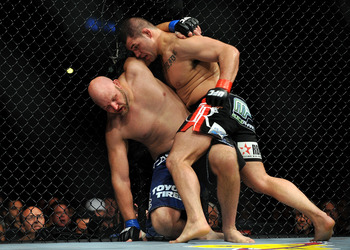 LOS ANGELES, CA - OCTOBER 24:  UFC fighter Cain Velasquez (R) hits UFC fighter Ben Rothwell (L) up against the fence during their Heavyweight bout at UFC 104: Machida vs. Shogun at Staples Center on October 24, 2009 in Los Angeles, California.  Velasquez