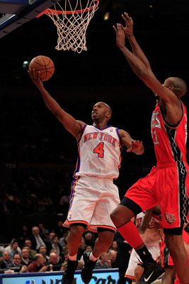 NEW YORK, NY - MARCH 30: Chauncey Billups #4 of the New York Knicks shoots over Travis Outlaw#21 of the New Jersey Nets at Madison Square Garden on March 30, 2011 in New York City. NOTE TO USER: User expressly acknowledges and agrees that, by downloading