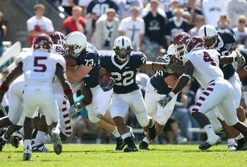 STATE COLLEGE, PA - SEPTEMBER 19: Running back Evan Royster #22 of the Penn State Nittany Lions carries the ball during a game against the Temple Owls on September 19, 2009 at Beaver Stadium in State College, Pennsylvania. (Photo by Hunter Martin/Getty Im