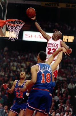 Chicago''s Michael Jordan rises above Cavaliers Larry Nance and John Wiliams during the Bulls'' 91-84 victory in the second round of the 1993 NBA playoffs. Mandatory Credit: Jonathan Daniel/ALLSPORT