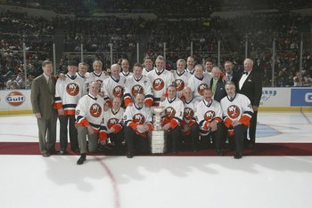 UNIONDALE, NY - MARCH 4:  Memebers of the 1980 New York Islanders pose for a team photo during a ceremony honoring the 25th anniversary of the Islanders first Stanley Cup victory held on March 4, 2006 at the Nassau Coliseum in Uniondale, New York.  (Photo