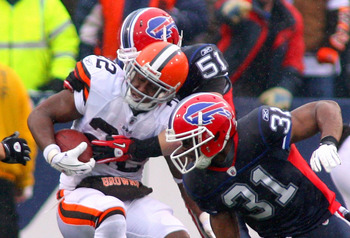 ORCHARD PARK, NY - DECEMBER 12: Mike Bell #22 of the Cleveland Browns is tackled by Paul Posluszny #51 of the Buffalo Bills  at Ralph Wilson Stadium on December 12, 2010 in Orchard Park, New York.  (Photo by Rick Stewart/Getty Images)