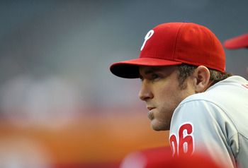 PHOENIX, AZ - APRIL 26:  Chase Utley #26 of the Philadelphia Phillies watches from the dugout during the Major League Baseball game against the Arizona Diamondbacks at Chase Field on April 26, 2011 in Phoenix, Arizona. The Diamondbacks defeated the Philli
