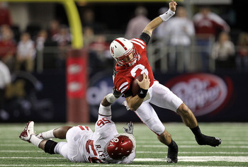 ARLINGTON, TX - DECEMBER 04:  Quarterback Taylor Martinez #3 of the Nebraska Cornhuskers is tackled by Ronnell Lewis #56 of the Oklahoma Sooners during the Big 12 Championship at Cowboys Stadium on December 4, 2010 in Arlington, Texas.  (Photo by Ronald M