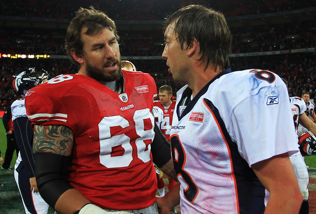 LONDON, ENGLAND - OCTOBER 31:  Quarterback Kyle Orton #8 of Denver Broncos and Adam Snyder #68 of San Francisco 49ers talk after the NFL International Series match between Denver Broncos and San Francisco 49ers at Wembley Stadium on October 31, 2010 in Lo