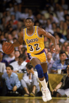LOS ANGELES - 1987:  Magic Johnson #32 of the Los Angeles Lakers dribbles the ball during an NBA game at the Great Western Forum in Los Angeles, California in 1987. (Photo by: Rick Stewart/Getty Images)