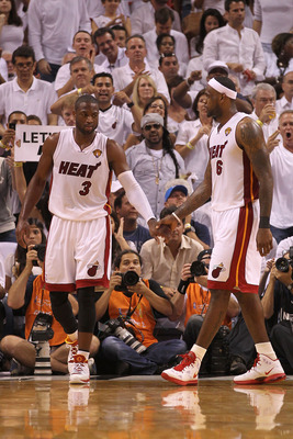 MIAMI, FL - JUNE 02:  (L-R) Dwyane Wade #3 and LeBron James #6 of the Miami Heat react after a play against the Dallas Mavericks in Game Two of the 2011 NBA Finals at American Airlines Arena on June 2, 2011 in Miami, Florida. NOTE TO USER: User expressly