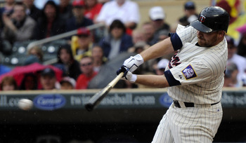MINNEAPOLIS, MN - MAY 29: Jason Kubel #16 of the Minnesota Twins hits an RBI single against the Los Angeles Angels of Anaheim during the first inning of their game on May 29, 2011 at Target Field in Minneapolis, Minnesota. (Photo by Hannah Foslien/Getty I