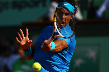PARIS, FRANCE - JUNE 01:  Rafael Nadal of Spain hits a backhand during the men's singles quarterfinal match between Rafael Nadal of Spain and Robin Soderling of Sweden on day eleven of the French Open at Roland Garros on June 1, 2011 in Paris, France.  (P