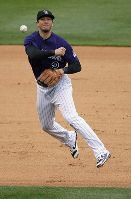 DENVER, CO - MAY 12:  Shortstop Troy Tulowitzki #2 of the Colorado Rockies throws out a runner against the New York Mets at Coors Field on May 12, 2011 in Denver, Colorado.  (Photo by Doug Pensinger/Getty Images)