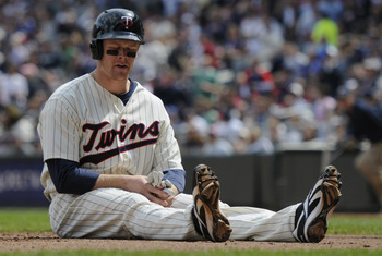 MINNEAPOLIS, MN - APRIL 24: Justin Morneau #33 of the Minnesota Twins reacts after being tagged out at home plate for the final out of the third inning against the Cleveland Indians during their game on April 24, 2011 at Target Field in Minneapolis, Minne