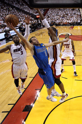 MIAMI, FL - JUNE 02:  Jose Juan Barea #11 of the Dallas Mavericks drives for a shot attempt against Chris Bosh #1 and Dwyane Wade #3 of the Miami Heat in Game Two of the 2011 NBA Finals at American Airlines Arena on June 2, 2011 in Miami, Florida. NOTE TO