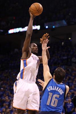 OKLAHOMA CITY, OK - MAY 23:  Serge Ibaka #9 of the Oklahoma City Thunder shoots over Peja Stojakovic #16 of the Dallas Mavericks in the second half in Game Four of the Western Conference Finals during the 2011 NBA Playoffs at Oklahoma City Arena on May 23