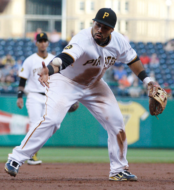 PITTSBURGH - MAY 09:  Pedro Alvarez #24 of the Pittsburgh Pirates attempts to handle the ball down the third base line during the game against the Los Angeles Dodgers on May 9, 2011 at PNC Park in Pittsburgh, Pennsylvania.  (Photo by Jared Wickerham/Getty