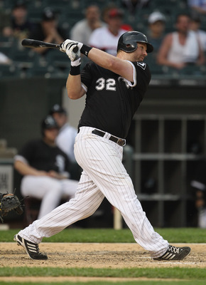 CHICAGO, IL - MAY 22: Adam Dunn #32 of the Chicago White Sox hits a run-scoring single in the 8th inning against the Los Angeles Dodgers at U.S. Cellular Field on May 22, 2011 in Chicago, Illinois. The White Sox defeated the Dodgers 8-3. (Photo by Jonatha