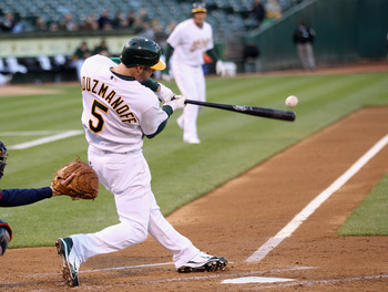 OAKLAND, CA - MAY 18:  Kevin Kouzmanoff #5 of the Oakland Athletics singles in two runs in the second inning against the Minnesota Twins at Oakland-Alameda County Coliseum on May 18, 2011 in Oakland, California.  (Photo by Ezra Shaw/Getty Images)