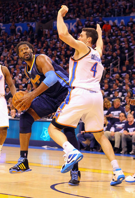 OKLAHOMA CITY, OK - APRIL 27: Nene Hilario #31 of the Denver Nuggets looks to shoot the ball against Nick Collison #4 of the Oklahoma City Thunder in Game Five of the Western Conference Quarterfinals in the 2011 NBA Playoffs on April 27, 2011 at the Ford