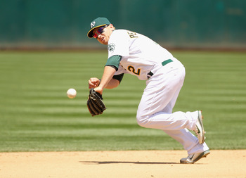 OAKLAND, CA - MAY 29:  Cliff Pennington #2 of the Oakland Athletics tries to field a ground ball during their game against the Baltimore Orioles at Oakland-Alameda County Coliseum on May 29, 2011 in Oakland, California.  (Photo by Ezra Shaw/Getty Images)