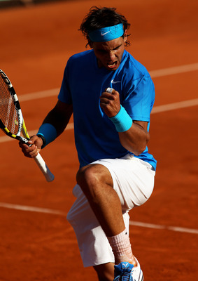 PARIS, FRANCE - JUNE 01:  Rafael Nadal of Spain celebrates a point during the men's singles quarterfinal match between Rafael Nadal of Spain and Robin Soderling of Sweden on day eleven of the French Open at Roland Garros on June 1, 2011 in Paris, France.