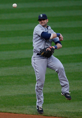 CLEVELAND - MAY 13: Adam Kennedy #4 of the Seattle Mariners turns and throws to first base against  the Cleveland Indians during the game on May 13, 2011 at Progressive Field in Cleveland, Ohio.  (Photo by Jared Wickerham/Getty Images)