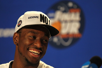 HOUSTON, TX - APRIL 04:  Kemba Walker #15 of the Connecticut Huskies speaks to the media after defeating the Butler Bulldogs to win the National Championship Game of the 2011 NCAA Division I Men's Basketball Tournament at Reliant Stadium on April 4, 2011
