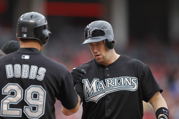 CINCINNATI, OH - MAY 1: John Buck #14 of the Florida Marlins celebrates with Greg Dobbs #29 after hitting a home run in the seventh inning against the Cincinnati Reds at Great American Ball Park on May 1, 2011 in Cincinnati, Ohio. The Marlins defeated the