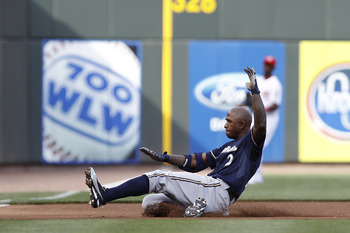 CINCINNATI, OH - JUNE 1: Nyjer Morgan #2 of the Milwaukee Brewers slides into third base with a triple in the first inning against the Cincinnati Reds at Great American Ball Park on June 1, 2011 in Cincinnati, Ohio. (Photo by Joe Robbins/Getty Images)