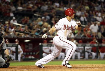 PHOENIX, AZ - MAY 17:  Gerardo Parra #8 of the Arizona Diamondbacks hits a two RBI single against the San Diego Padres during the sixth inning of the Major League Baseball game at Chase Field on May 17, 2011 in Phoenix, Arizona.  (Photo by Christian Peter