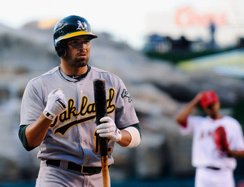 ANAHEIM, CA - MAY 25:  David DeJesus #12 of the Oakland Athletics at bat against the Los Angeles Angels of Anaheim during the baseball game at Angel Stadium of Anaheim on May 25, 2011 in Anaheim, California.  (Photo by Kevork Djansezian/Getty Images)