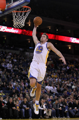 OAKLAND, CA - MARCH 25: David Lee #10 of the Golden State Warriors goes up for a dunk against the Toronto Raptors at Oracle Arena on March 25, 2011 in Oakland, California. NOTE TO USER: User expressly acknowledges and agrees that, by downloading and or us