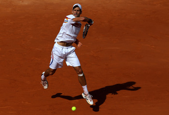 PARIS, FRANCE - MAY 29:  Novak Djokovic of Serbia hits a forehand during the men's singles round four match between Richard Gasquet of France and Novak Djokovic of Serbia on day eight of the French Open at Roland Garros on May 29, 2011 in Paris, France.