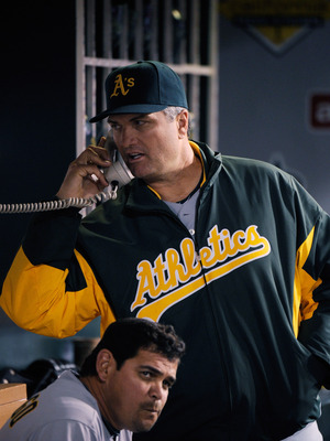 ANAHEIM, CA - MAY 25:  Manager Bob Geren (R) of the Oakland Athletics calls the bull pen during the baseball game against the Los Angeles Angels of Anaheim at Angel Stadium of Anaheim on May 25, 2011 in Anaheim, California. (Photo by Kevork Djansezian/Get