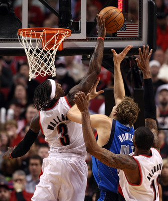 PORTLAND, OR - APRIL 21:  Gerald Wallace #3 of the Portland Trail Blazers blocks the shot of Dirk Nowitzki #41 of the Dallas Mavericks in Game Three of the Western Conference Quarterfinals in the 2011 NBA Playoffs on April 21, 2011 at the Rose Garden in P