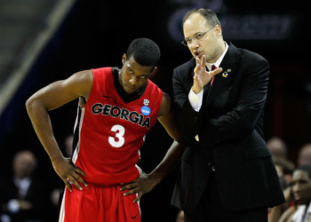 CHARLOTTE, NC - MARCH 18:  Head coach Mark Fox of the Georgia Bulldogs talks with Dustin Ware #3 in the first half while taking on the Washington Huskies during the second round of the 2011 NCAA men's basketball tournament at Time Warner Cable Arena on Ma