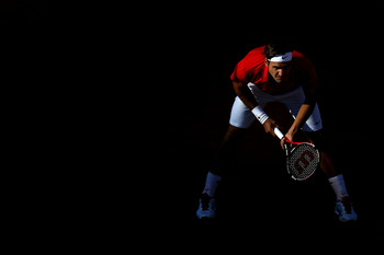 PARIS, FRANCE - MAY 31:  Roger Federer of Switzerland awaits a serve during the men's singles quarterfinal match between Gael Monfils of France and Roger Federer of Switzerland on day ten of the French Open at Roland Garros on May 31, 2011 in Paris, Franc