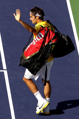 INDIAN WELLS, CA - MARCH 19:  Roger Federer of Switzerland leaves the court after loosing to Novak Djokovic of Serbia during the semifinals of the BNP Paribas Open at the Indian Wells Tennis Garden on March 19, 2011 in Indian Wells, California.  (Photo by