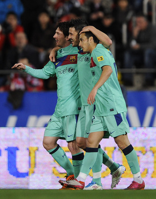 MALLORCA, SPAIN - FEBRUARY 26:  David Villa of FC Barcelona (C) celebrates with his team-mates Lionel Messi (L) and Pedro Rodriguez after scoring his second team's goal under a challenge of Dudu Aouate of Mallorca during the La Liga match between Mallorca