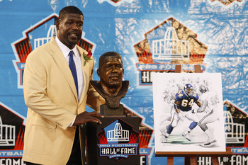 CANTON, OH - AUGUST 8: Randall McDaniel poses with his bust at his induction into the Pro Football Hall of Fame during the 2009 enshrinement ceremony at Fawcett Stadium on August 8, 2009 in Canton, Ohio. (Photo by Joe Robbins/Getty Images)