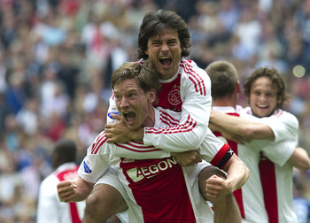 AMSTERDAM, THE NETHERLANDS - MAY 15:  Jan Vertonghen and Dario Cvitanich of Ajax Amsterdam celebrates during the Eridivisie match between Ajax Amsterdam and FC Twente at the Amsterdam Arena on May 15, 2010 in Amsterdam, The Netherlands.  (Photo by Toussai