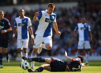 BLACKBURN, ENGLAND - APRIL 30:  Phil Jones of Blackburn Rovers is tackled by Tamir Cohen of Bolton Wanderers during the Barclays Premier League match between Blackburn Rovers and Bolton Wanderers at Ewood Park on April 30, 2011 in Blackburn, England.  (Ph