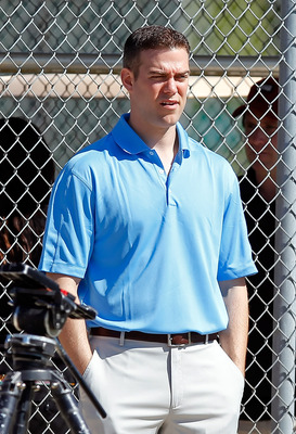 FORT MYERS, FL - FEBRUARY 19:  General Manager Theo Epstein of the Boston Red Sox watches the team during a Spring Training Workout Session at the Red Sox Player Development Complex on February 19, 2011 in Fort Myers, Florida.  (Photo by J. Meric/Getty Im