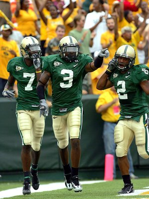 WACO, TX - SEPTEMBER 3:  Wide receiver Mikail Baker #3 of the Baylor Bears celebrates a touchdown during play against the TCU Horned Frogs on September 3, 2006 at Floyd Casey Stadium in Waco, Texas.  (Photo by Ronald Martinez/Getty Images)